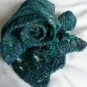 Handspun, handknit chunky lacy scarf in the deep blue-greens of the ocean, made in Scotland